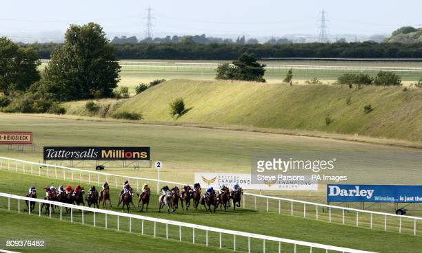 Albaqaa ridden by Pat Cosgrave beats My Freedom ridden by Frankie Dettori to win the TurfTV Handicap Stakes during the July Festival at Newmarket...