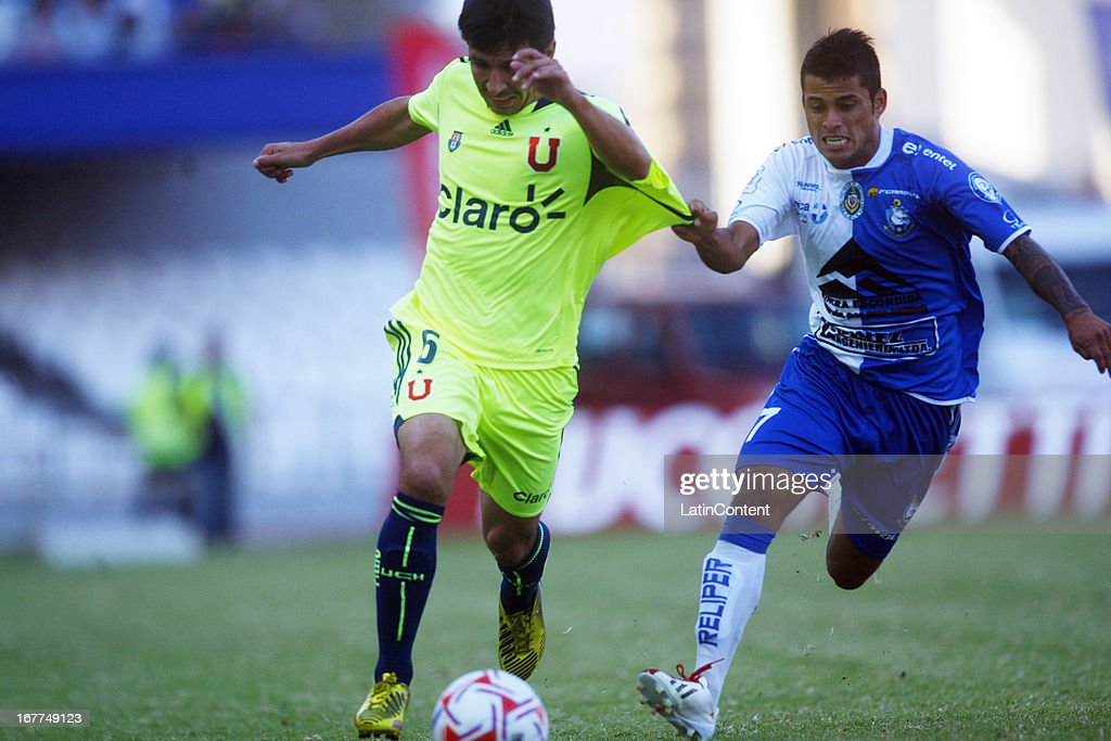 Albert Acevedo of Universidad de Chile, struggles for the ball with Sebastián Martínez of Antofagasta during a match between Universidad de Chile and Antofagasta as part of the Torneo Transicion 2013 at Bicentenario Calvo y Bascunan stadium on April 28, 2013 in Antofagasta, Chile.