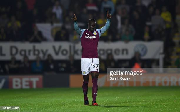 Albert Adomah of Aston Villa celebrates scoring his team's 2nd goal during the Sky Bet Championship match between Burton Albion and Aston Villa at...