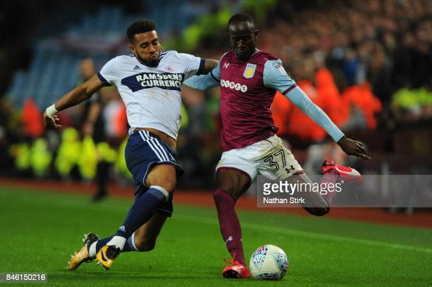 Albert Adomah of Aston Villa is tackled by Cyrus Christie of Middlesbrough during the Sky Bet Championship match between Aston Villa and...