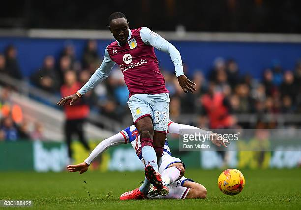 Albert Adomah of Aston Villa is tackled by Massimo Luongo of Queens Park Rangers during the Sky Bet Championship match between Queens Park Rangers...