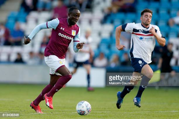 Albert Adomah of Aston Villa runs with the ball ahead of Jack Rea of AFC Telford United during the PreSeason Friendly between AFC Telford United and...