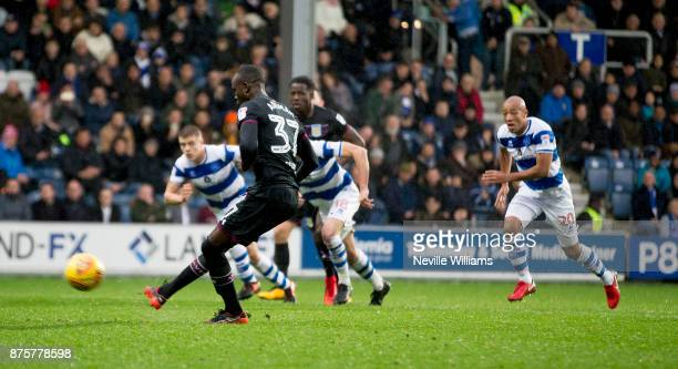 Albert Adomah of Aston Villa scores for Aston Villa from the penalty spot during the Sky Bet Championship match between Queens Park Rangers and Aston...