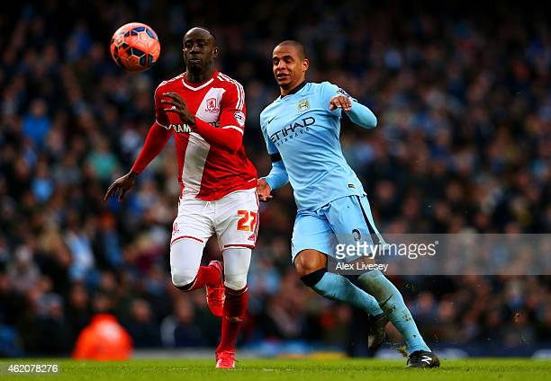 Albert Adomah of Middlesbrough chases an underhit backpass from Fernando of Manchester City during the FA Cup Fourth Round match between Manchester...