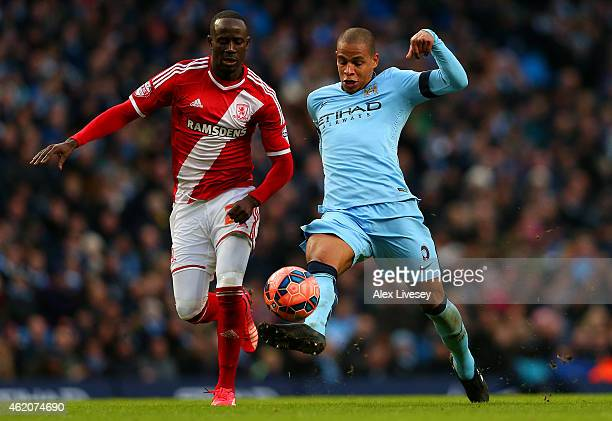Albert Adomah of Middlesbrough chases Fernando of Manchester City as he underhits a backpass to Wilfredo Caballero of Manchester City leading to the...