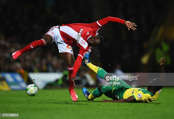 Albert Adomah of Middlesbrough is tackled by Alexander Tettey of Norwich City during the Sky Bet Championship match between Norwich City and...