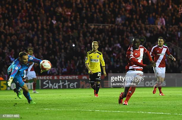 Albert Adomah of Middlesbrough shoots past goalkeeper David Button of Brentford to score their third goal during the Sky Bet Championship Playoff...
