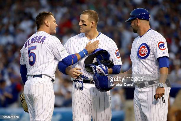 Albert Almora Jr #5 and Anthony Rizzo of the Chicago Cubs meet after the eighth inning against the Washington Nationals during game three of the...