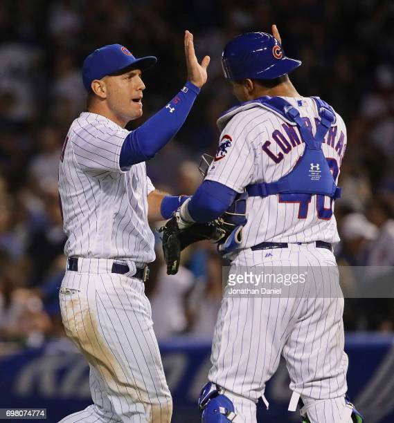 Albert Almora Jr #5 and Willson Contreras of the Chicago Cubs celebrate a win over the San Diego Padres at Wrigley Field on June 19 2017 in Chicago...