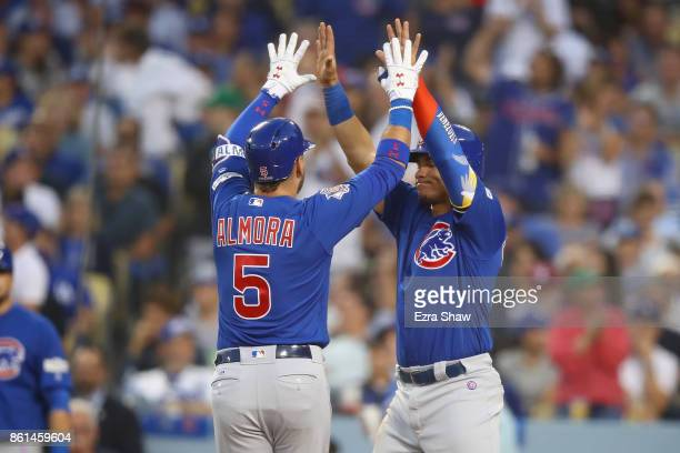 Albert Almora Jr #5 of the Chicago Cubs celebrates after hitting a two run home run against Clayton Kershaw of the Los Angeles Dodgers during the...