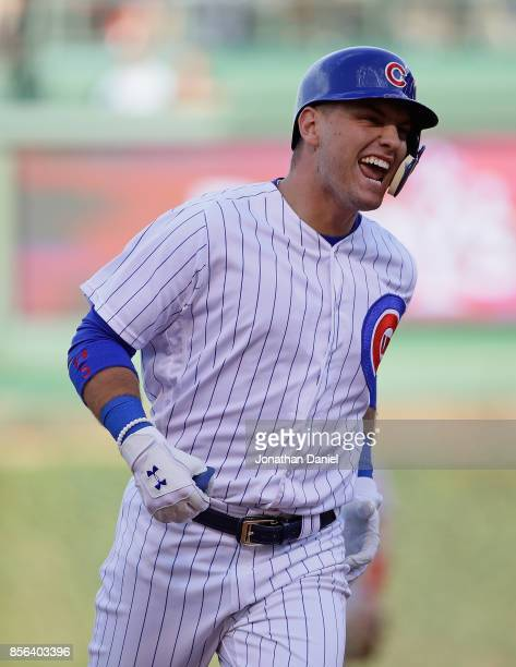 Albert Almora Jr #5 of the Chicago Cubs celebrates as he runs the bases after hitting a solo home run in the 9th inning against the Cincinnati Reds...