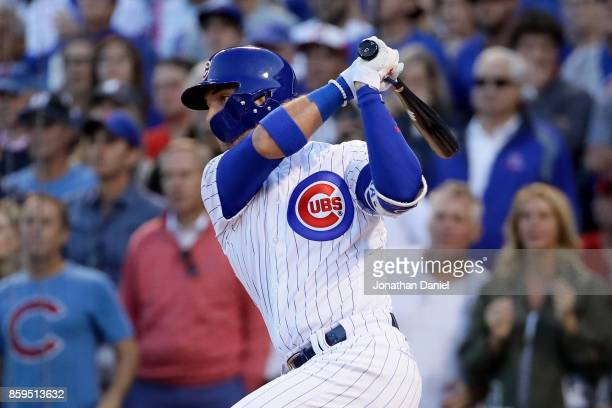Albert Almora Jr #5 of the Chicago Cubs hits a double in the seventh inning against the Washington Nationals during game three of the National League...