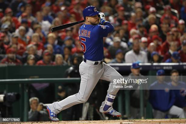 Albert Almora Jr #5 of the Chicago Cubs hits a single against the Washington Nationals during the first inning in game five of the National League...