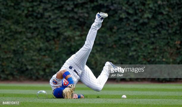 Albert Almora Jr #5 of the Chicago Cubs is unable to make a diving catch on a ball hit by Jose Martinez of the St Louis Cardinals during the fourth...