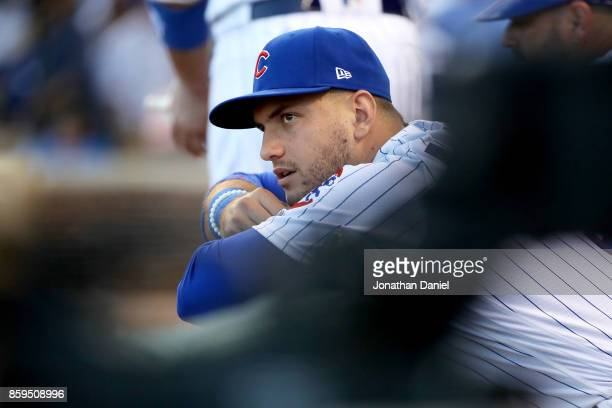 Albert Almora Jr #5 of the Chicago Cubs looks on from the dugout in the sixth inning against the Washington Nationals during game three of the...