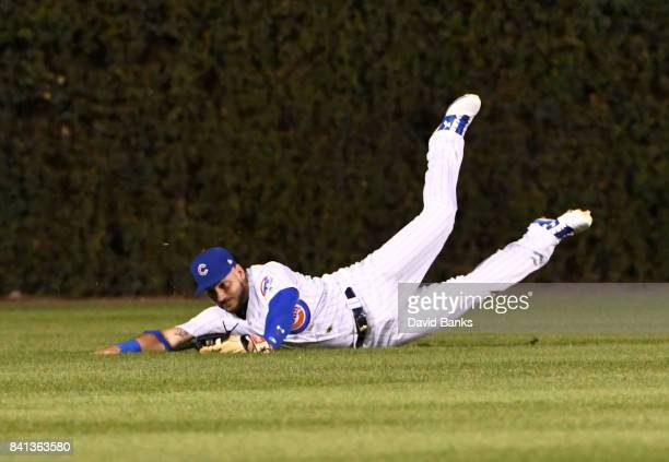Albert Almora Jr #5 of the Chicago Cubs make a catch on Freddie Freeman of the Atlanta Braves during the fifth inning on August 31 2017 at Wrigley...