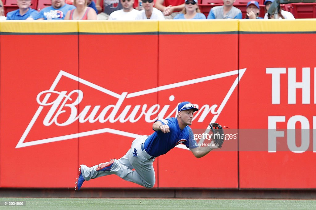 Albert Almora Jr. #5 of the Chicago Cubs makes a diving catch in center field in the seventh inning of the game against the Cincinnati Reds at Great American Ball Park on June 29, 2016 in Cincinnati, Ohio. The Cubs defeated the Reds 9-2.