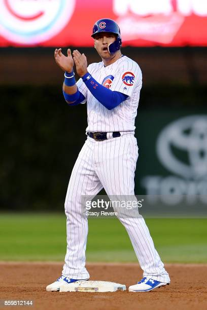 Albert Almora Jr #5 of the Chicago Cubs reacts after hitting a double in the seventh inning against the Washington Nationals during game three of the...