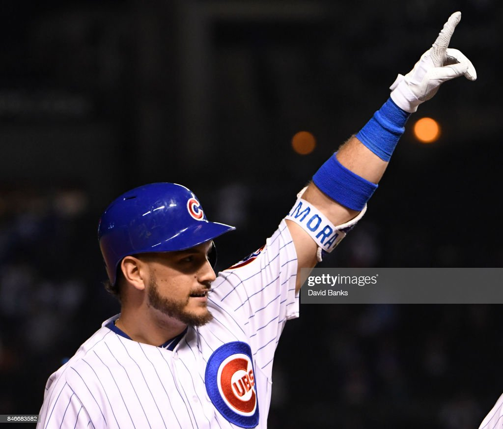 Albert Almora Jr. #5 of the Chicago Cubs reacts after hitting a three-RBI triple against the New York Mets during the eighth inning on September 13, 2017 at Wrigley Field in Chicago, Illinois.