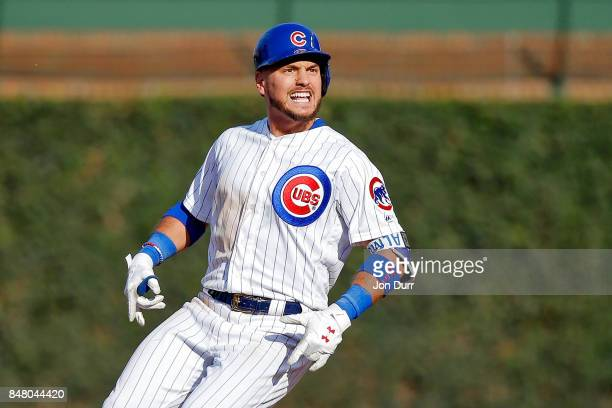 Albert Almora Jr #5 of the Chicago Cubs reacts after hitting an RBI double against the St Louis Cardinals during the fifth inning at Wrigley Field on...