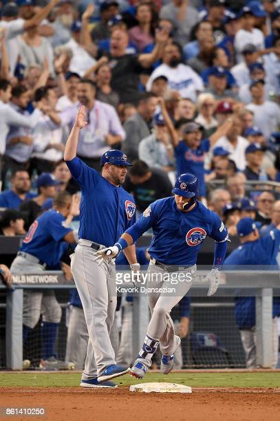 Albert Almora Jr #5 of the Chicago Cubs rounds the bases after hitting a two run home run against Clayton Kershaw of the Los Angeles Dodgers during...