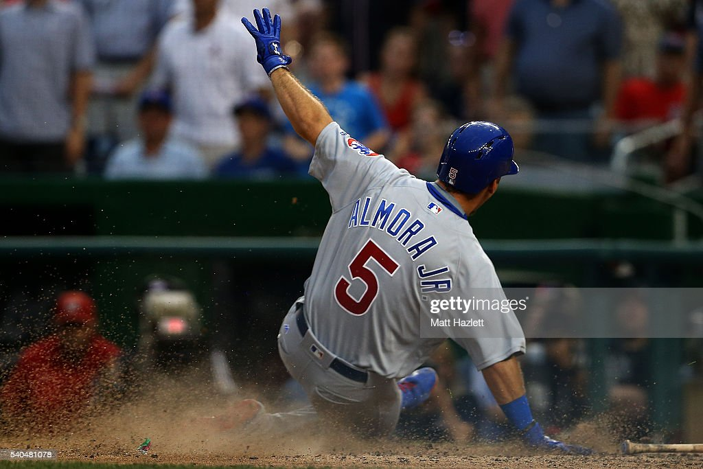 Albert Almora Jr. #5 of the Chicago Cubs scores in the twelfth inning against the Washington Nationals at Nationals Park on June 15, 2016 in Washington, DC.