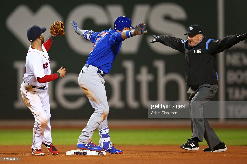Albert Almora Jr. #5 of the Chicago Cubs slides safely into second base in the fourth inning of a game against the Boston Red Sox at Fenway Park on April 30, 2017 in Boston, Massachusetts.