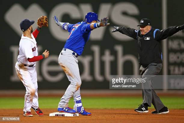 Albert Almora Jr #5 of the Chicago Cubs slides safely into second base in the fourth inning of a game against the Boston Red Sox at Fenway Park on...
