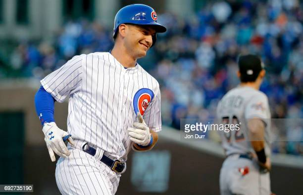 Albert Almora Jr #5 of the Chicago Cubs smiles as he rounds the bases after hitting a home run against the Miami Marlins during the fourth inning at...