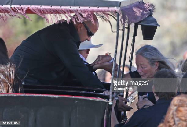 Albert Alvarado helps his motherinlaw into a carriage after the funeral of his wife and her daughter Heather Lorraine Alvarado on October 13 2017 in...