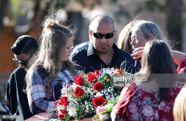 Albert Alvarado his daughter and his motherinlaw pay their final respects at the casket of his wife Heather Lorraine Alvarado on October 13 2017 in...