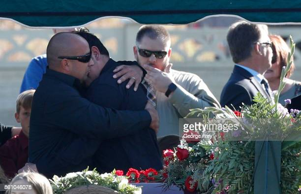 Albert Alvarado is given a hug by the casket of his wife Heather Lorraine Alvarado on October 13 2017 in Enoch Utah Alvarado was a 35 year old wife...
