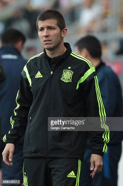 Albert Celades coach of Spain looks at his team during the UEFA European Under21 Championship playoff second leg match between Spain and Serbia at...
