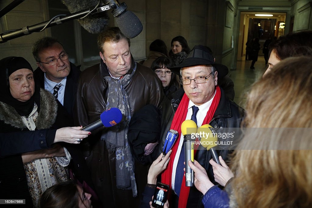 Albert Chennouf-Meyer (R), the father of late paratrooper Abel Chennouf killed by Islamist gunman Mohamed Merah in Montauban in March 2012, speaks to the media beside Olivier Morice (2ndL), the lawyer of relatives of Merah's other victim, Mohammed Legouad, upon their arrival at Paris courthouse on February 25, 2013 before meeting the investigating anti-terror judges.