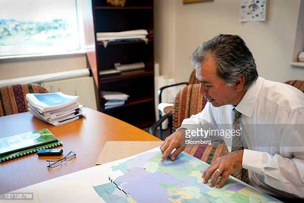 Albert Damon director of the Navajo Nation Division of Economic Development views a map of active business leases at his office in Window Rock...