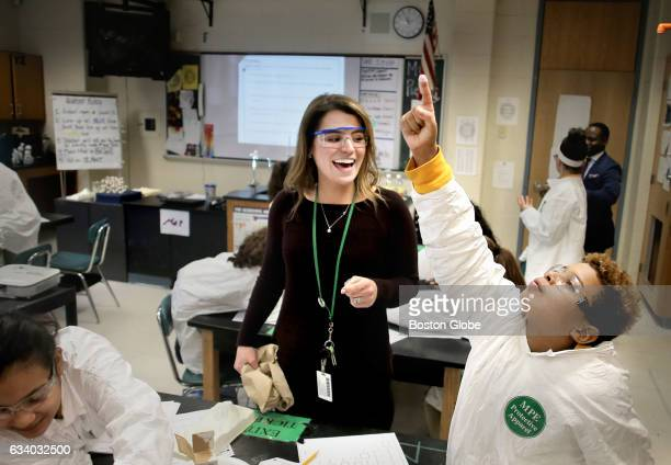 Albert Delanuez reacts after dipping his finger in a baking soda and vinegar volcano in Zoe Pierce's sixth grade science class at the Impact School...