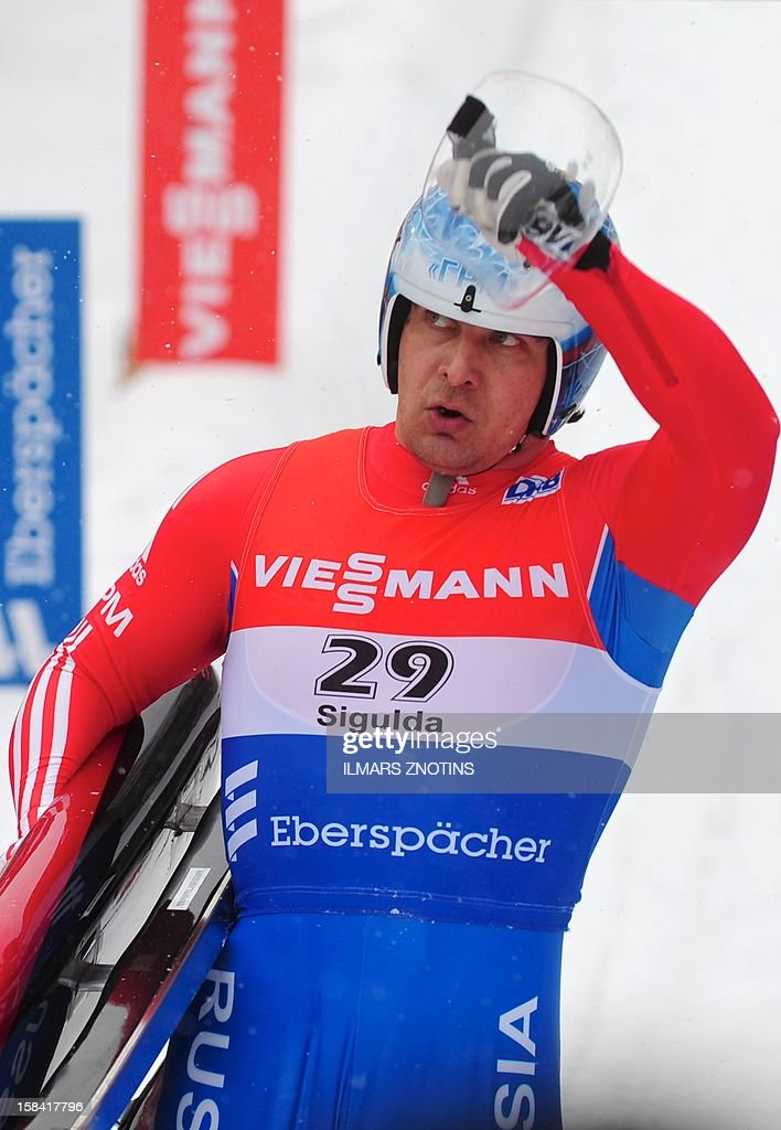 Albert Demchenko of Russia celebrates after winning the Luge World Cup Man competition on December 16 , 2012 in Sigulda, Latvia, some 50 km northeast of Riga. Demchenko won the event ahead of Armin Zoeggeler (2nd) of Italy and Felix Loch (3rd) of Germany.