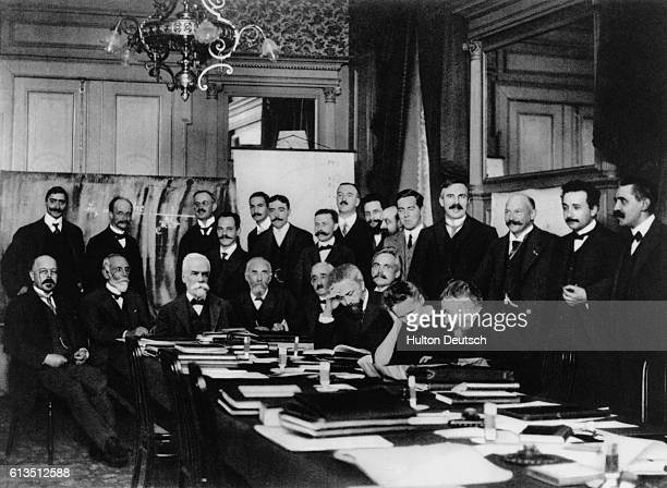 Albert Einstein and Marie Curie amongst a group of fellow scientists at a conference in Brussels Seated W Nernst M Brillouin E Solvay H Lorentz E...