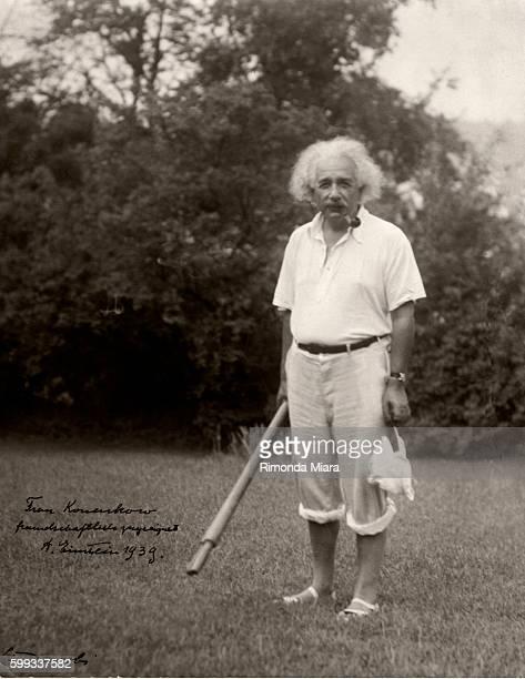 Albert Einstein smoking a pipe