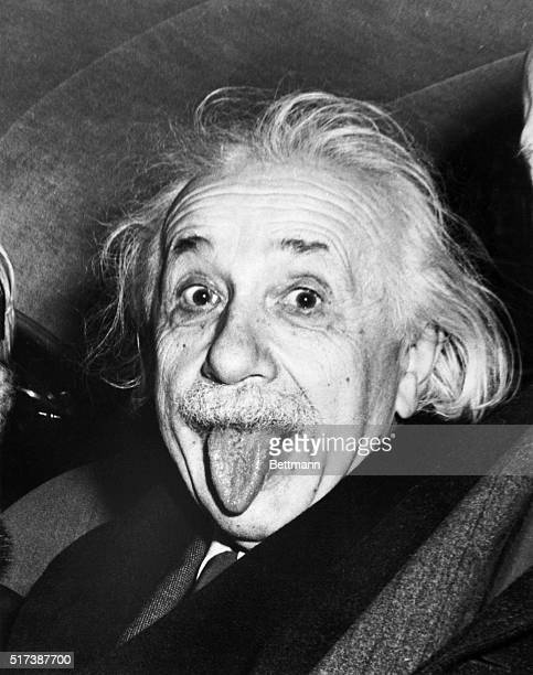 Albert Einstein sticks out his tongue when asked by photographers to smile on the occasion of his 72nd birthday on March 14 1951
