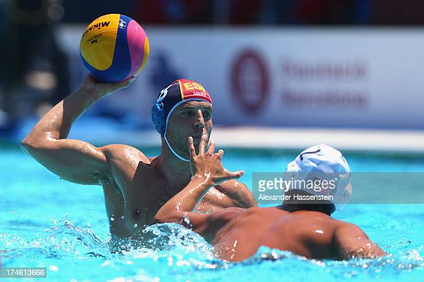 Albert Espanol of Spain in action with Janson Wigo of US during the Men's Water Polo quarterfinals qualification match between United Sates of...
