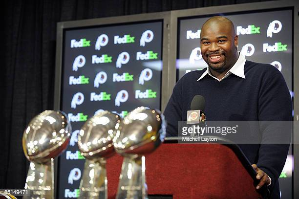 Albert Haynesworth attends a press conference after signing a 7year contract worth approximately $100 million with the Washington Redskins on...