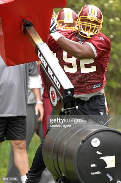 Albert Haynesworth of the Washington Redskins runs through drills during minicamp on May 1 2009 at Redskins Park in Ashurn Virginia
