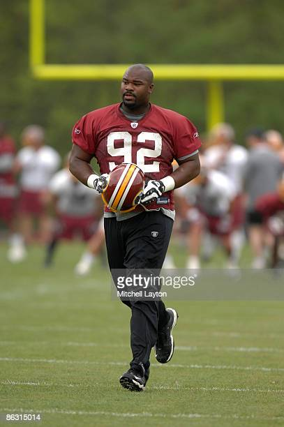 Albert Haynesworth of the Washington Redskins walks to drills during minicamp on May 1 2009 at Redskins Park in Ashurn Virginia