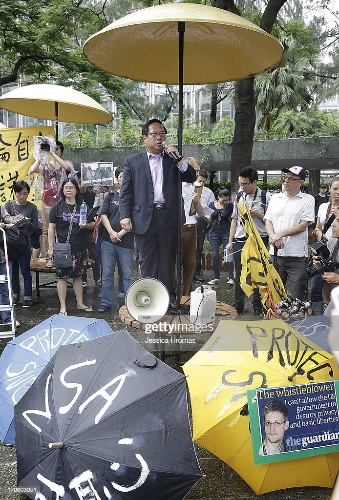 Albert Ho Chairman of Hong Kong Alliance and Ex- Democratic Party Leader addresses the protest crowd in Charter Garden at the start of the protest rally to support Edward Snowden on June 15, 2013 in Hong Kong, Hong Kong. Former CIA employee Edward Snowden is accused of leaking details of top-secret US surveillance of phones and internet.
