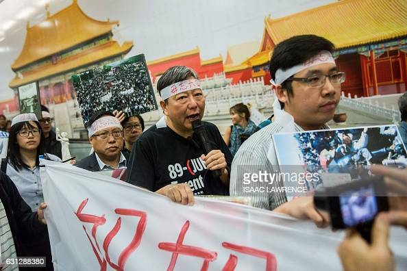 Albert Ho politician and chairman of the Hong Kong Alliance in Support of Patriotic Democratic Movements in China demonstrates with other activists...