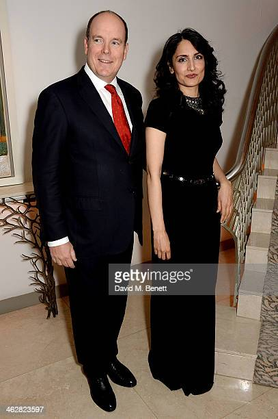 Albert II Prince of Monaco and Renu Mehta attend the Fortune Forum Champagne Reception at The Dorchester on January 15 2014 in London England