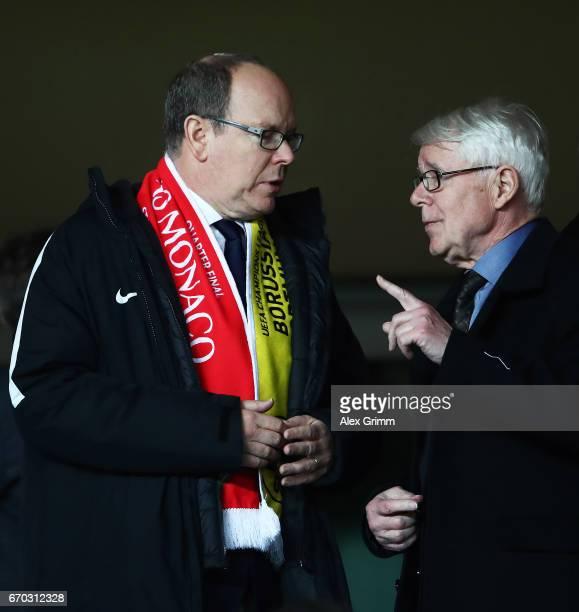 Albert II Prince of Monaco chats to Reinhard Rauball President of Borussia Dortmund during the UEFA Champions League Quarter Final second leg match...