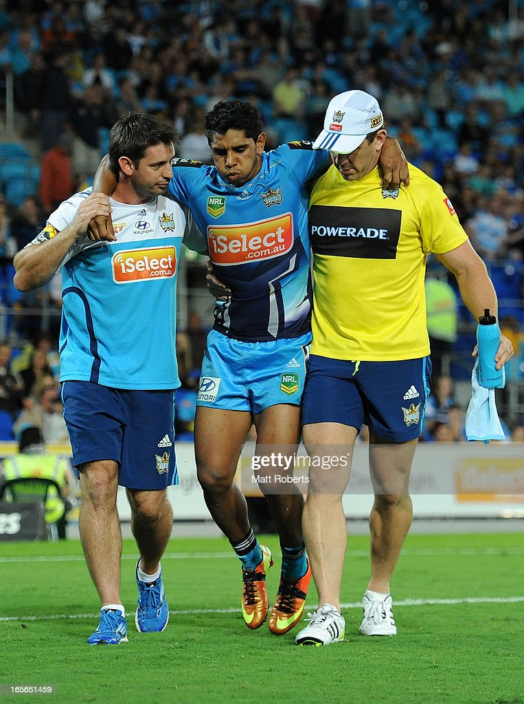 Albert Kelly of the Titans is helped from the field during the round five NRL match between the Gold Coast Titans and the Brisbane Broncos at Skilled Park on April 5, 2013 on the Gold Coast, Australia.