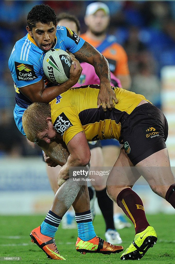 Albert Kelly of the Titans is tackled during the round five NRL match between the Gold Coast Titans and the Brisbane Broncos at Skilled Park on April 5, 2013 on the Gold Coast, Australia.